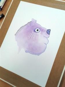 Tête d'ours rigolo apparu dans une tache d'aquarelle
