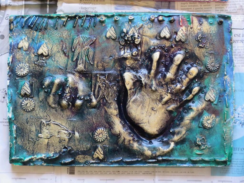Mise en valeur des reliefs avec de la cire à dorer