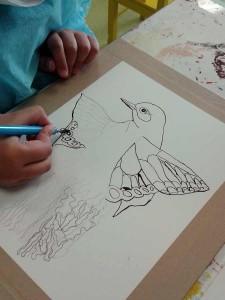 Les traits au crayon sont repassés à l'encre noire