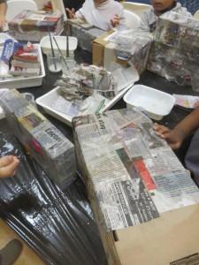 Recouvrir les boites de papier journal