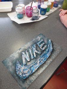 Cire argentée sur encre acrylique bleue