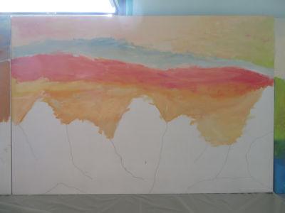 Le ciel est peint avant les montagnes