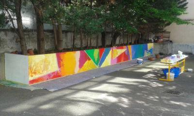 Fresque peinte dans la cours de l'école maternelle