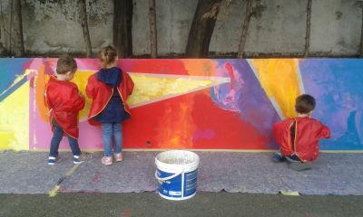 Création d'une fresque peinte dans la cours